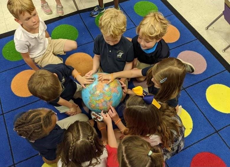 Children wth globe